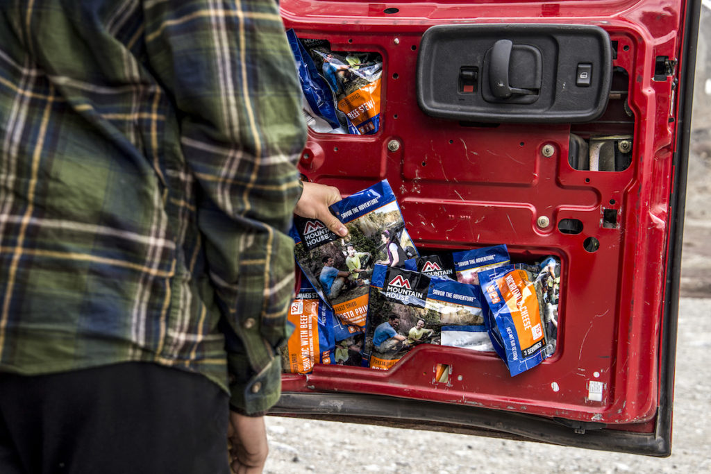 Inside of a car door stuffed with Mountain House meals