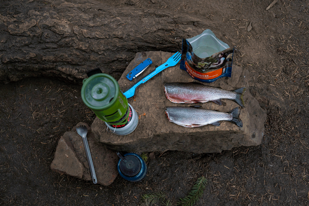JetBoil, two prepared fish, and an empty Mountain House pouch