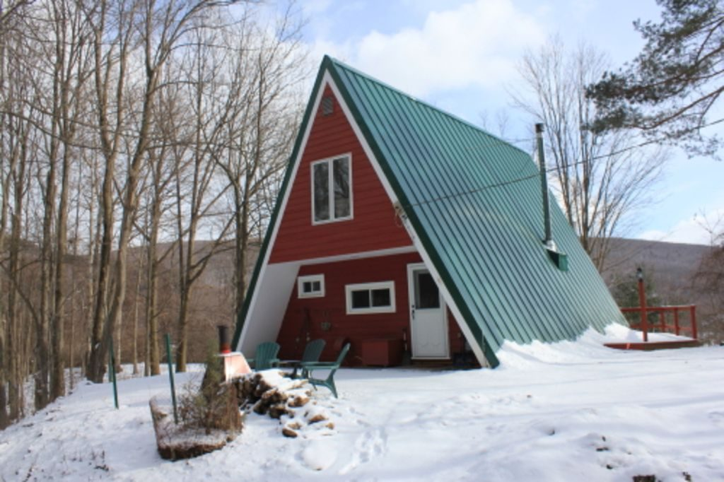 Red A-frame with snow on the ground
