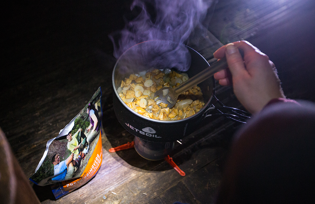 Mountain House pasta primavera and someone sauteeing garlic and mushrooms in a jetboil pot