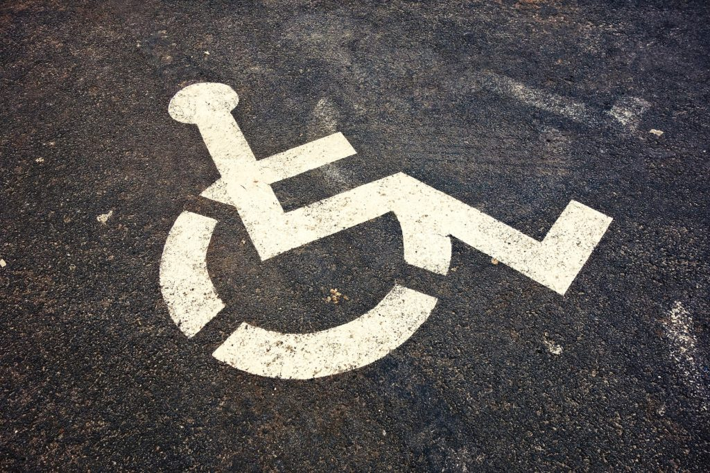 Wheelchair painted on concrete.