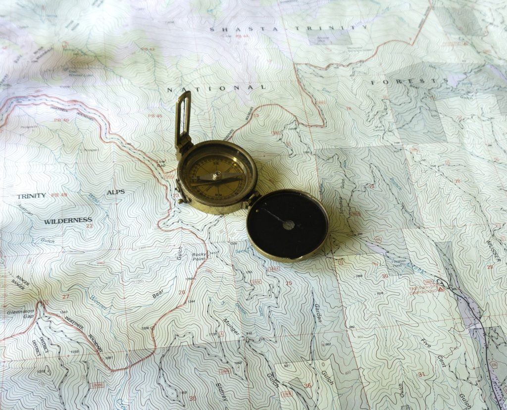 Topographic map and compass.