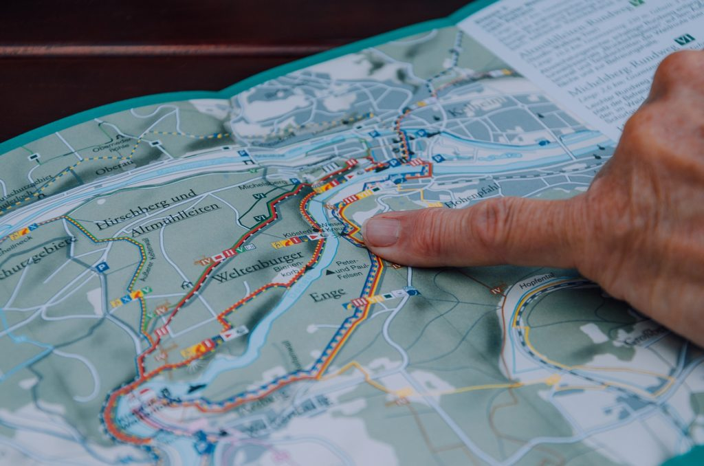 Finger pointing on trail map.