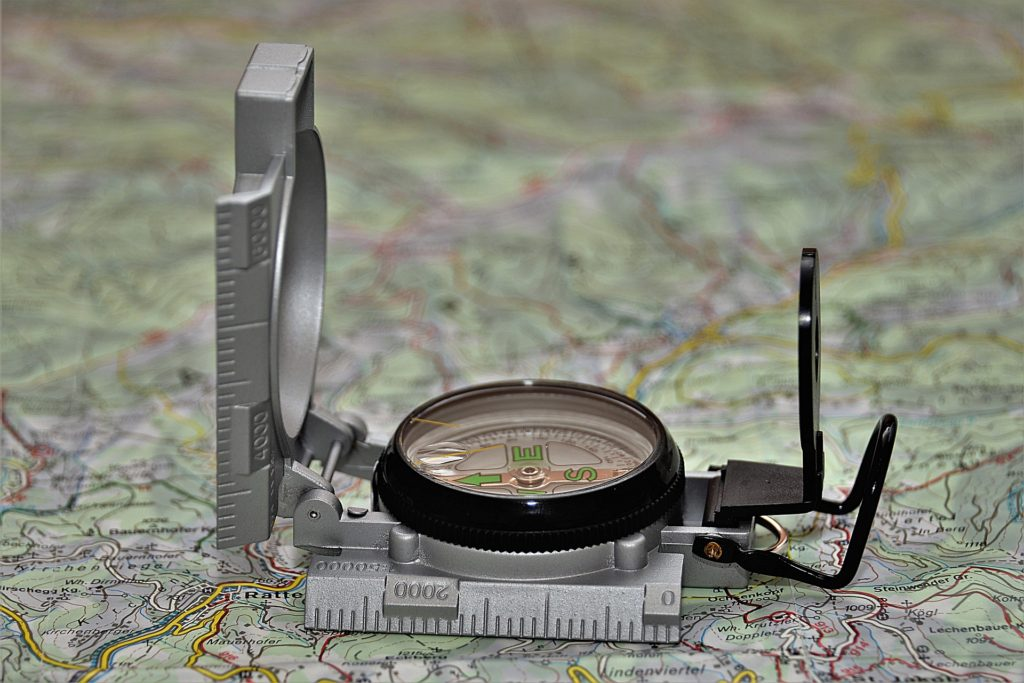 Compass opened on topographic map.